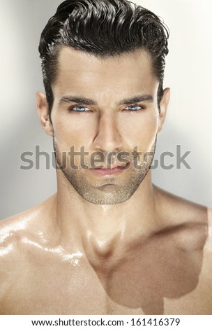 Close up portrait of a very handsome man - stock photo