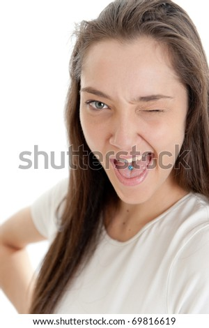Close-up portrait of a winking young woman - stock photo