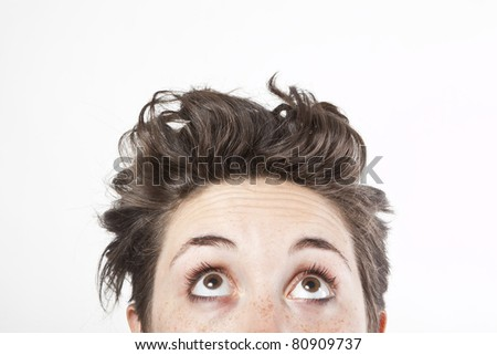 close up portrait of a woman looking up - stock photo
