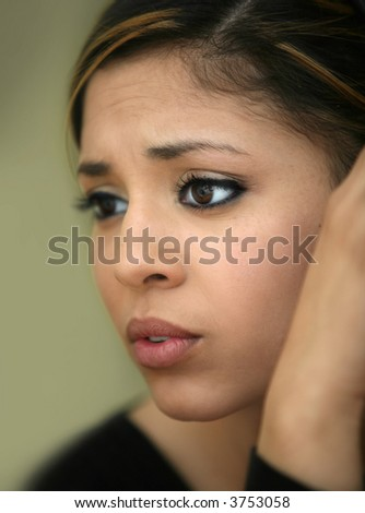 Close-up portrait of a worried teen girl - stock photo