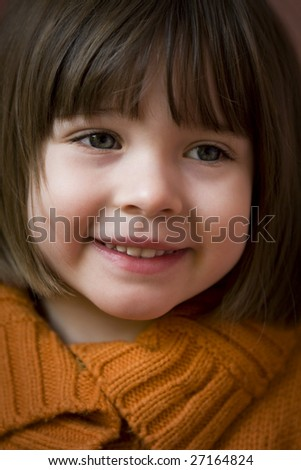 Close up portrait of a 3 year old girl - stock photo