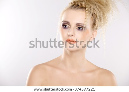 Close up portrait of a young adult attractive sexy and sensuality pretty woman with beautiful blond hairs and multicolor makeup isolated on white background