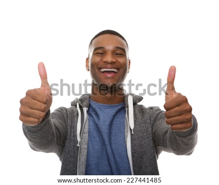 Close up portrait of a young african american man smiling with thumbs up sign - stock photo