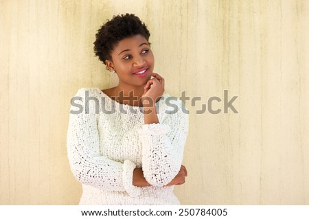 Close up portrait of a young african american woman thinking  - stock photo