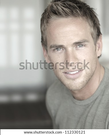 Close-up portrait of a young attractive man in modern cool style - stock photo