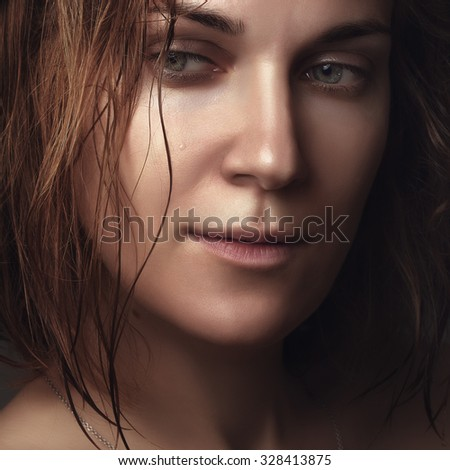 Close up portrait of a young beautiful girl. Wet beauty