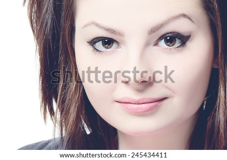 Close-up portrait of a young beautiful lady on white background. Toned and filtered photo - stock photo