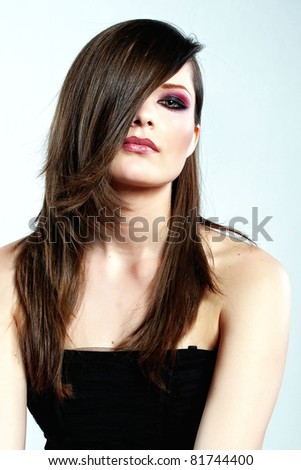 Close-up portrait of a young beautiful woman - stock photo