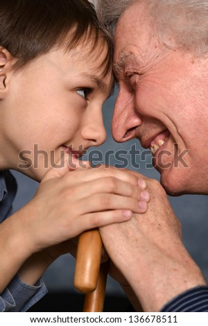 close-up portrait of a young boy and his grandfather