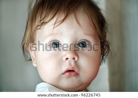 Close-up portrait of a young boy looking at camera. - stock photo