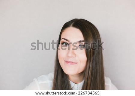close-up portrait of a young brunette girl - stock photo