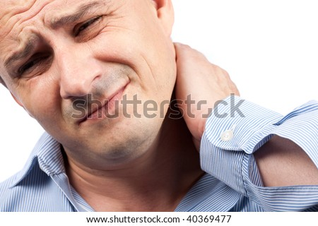Close up portrait of a young businessman with neck pain - stock photo