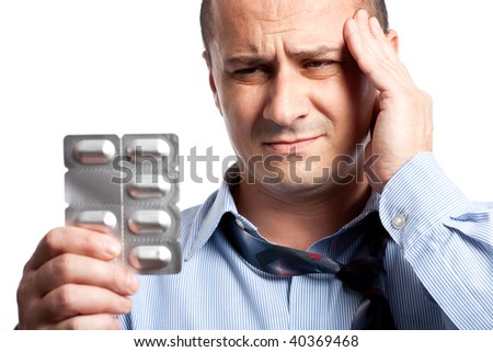Close up portrait of a young businessman with strong headache - stock photo