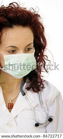 Close-up portrait of a young doctor - stock photo