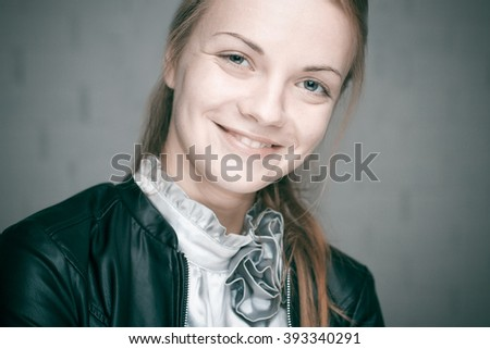 Close-up portrait of a young girl laughing. - stock photo
