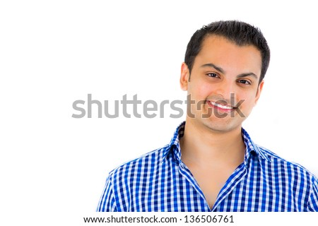 Close-up portrait of a young happy attractive guy isolated on white background with copy space - stock photo