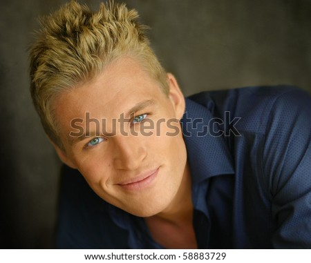 Close up portrait of a young happy blond man - stock photo