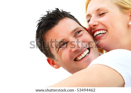 Close-up portrait of a young happy couple. Shallow DoF with focus on the man. - stock photo
