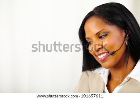 Close up portrait of a young isolated receptionist at work looking down - stock photo