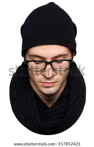 close-up portrait of a young man in a black hat and scarf isolated on white background - stock photo