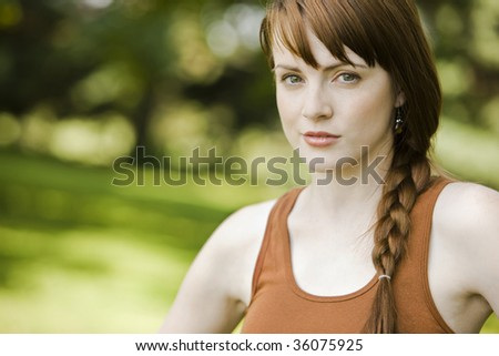 Close-up portrait of a young pretty woman staring - stock photo