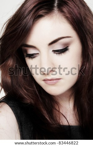 close up portrait of a young woman crying make up running down face - stock photo