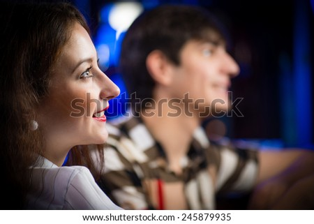 close-up portrait of a young woman in a bar - stock photo