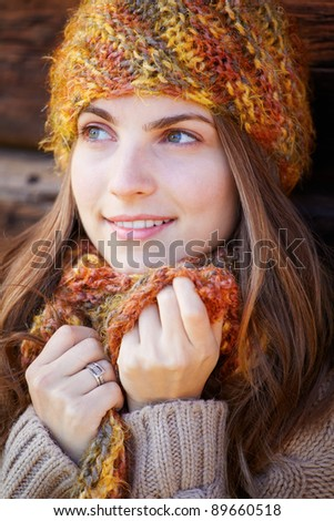 Close up portrait of a young woman in autumn smiling. - stock photo
