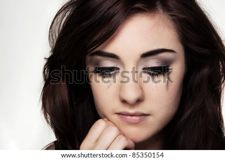 close up portrait of a young woman looking not to happy