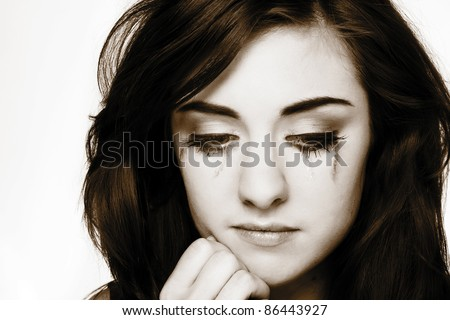 close up portrait of a young woman looking not to happy - stock photo