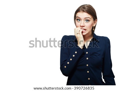 Close-up portrait of a young woman scared ,afraid and anxious biting her finger nails, looking to the camera, with wide opened eyes isolated on a white background. Human emotions - stock photo