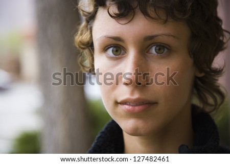 Close-up portrait of a young woman with short hair - stock photo