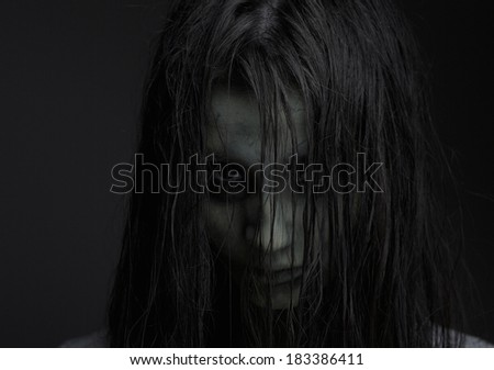 Close up portrait of a zombie girl with horror expression - stock photo