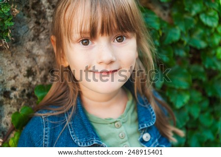 Close up portrait of adorable little girl of 4 years old - stock photo