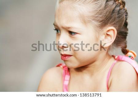 Close-up portrait of adorable sad child girl Sallow DOF - stock photo