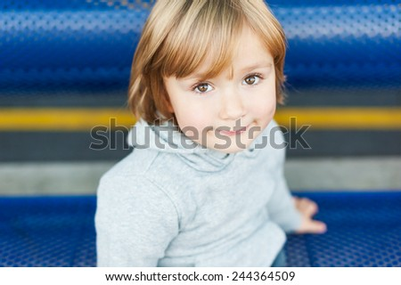 Close up portrait of adorable toddler boy - stock photo