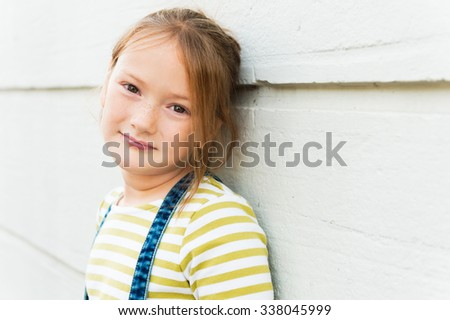 Close up portrait of adorable young 8 years old - stock photo