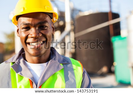 close up portrait of african american petrochemical worker outside the factory - stock photo