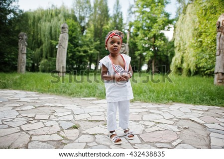 Close up portrait of african baby girl walking at park - stock photo