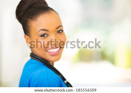 close up portrait of african female medical intern  - stock photo