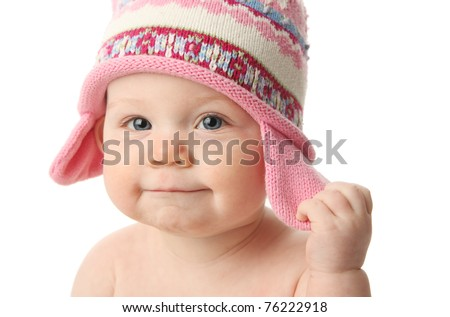 Close up portrait of an adorable baby wearing a knit winter cap, isolated on white - stock photo