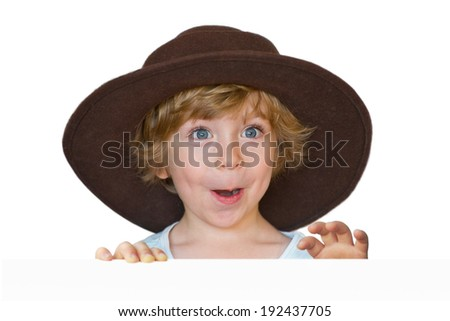Close-up Portrait of an adorable little boy with a big brown hat looking surprised isolated on white background - stock photo