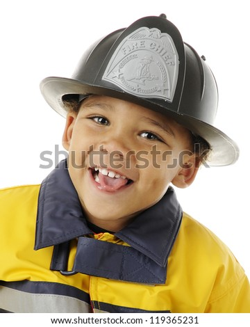 "Close-up portrait of an adorable preschool ""fire chief.""  On a white background."