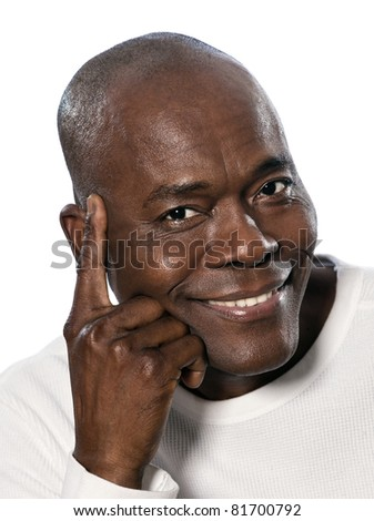 Close-up portrait of an afro American mature smiling man in studio on white isolated background - stock photo
