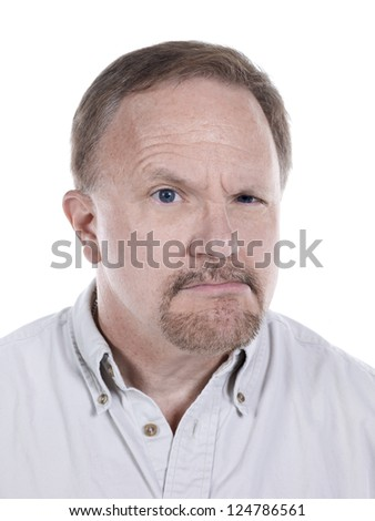 Close-up portrait of an angry old man wearing casual against the white surface
