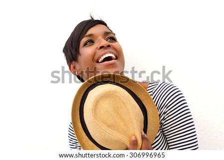 Close up portrait of an attractive african american woman holding hat - stock photo
