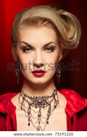 Close-up portrait of an attractive blond lady - stock photo