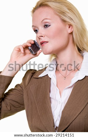 Close up portrait of an attractive blond woman wearing a brown colored business jacket talking on cell phone