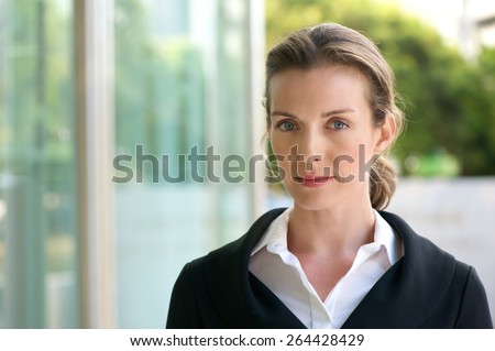 Close up portrait of an attractive business woman with serious face expression - stock photo