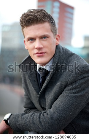 Close up portrait of an attractive businessman - stock photo